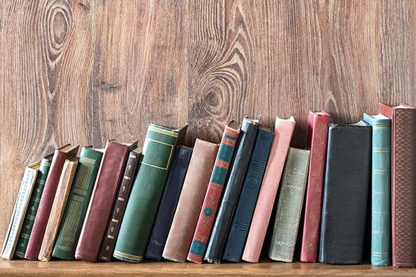 E3NDPP Old books on wooden shelf.